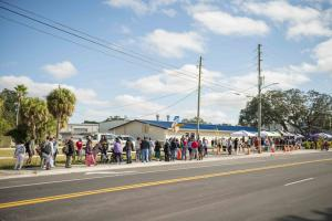 Hundreds line up to receive their Thanksgiving meal from SBT staff and O'Neal Larkin's volunteers on November 23rd.