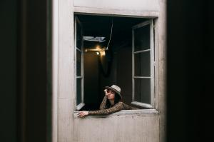 Bored woman looking out of window