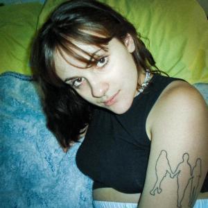 Upper body shot of Julianna Joy wearing a black short T-shirt.