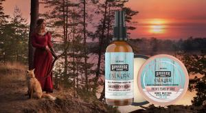 Woman warrior holding a bow with a fox standing at her feet while she stares off into the sunset. Valkyrie Edition Skin care Body Oil and Body Butter Balm made in Canada by Valhalla Legend.