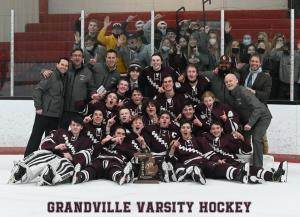 Grandville Varsity Hockey poses for team picture after winning 2021 Championship game.