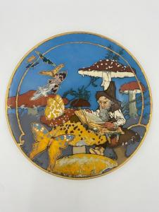 Beautiful Mettlach stoneware charger by Heinrich Schlitt, 17 ½ inches in diameter, the large circular form, signed ($3,321).