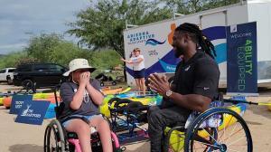 Wheelchair Basketball Player Matt Scott talking with young athlete