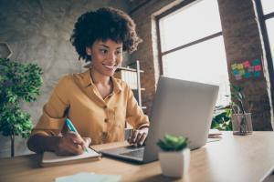 women smiling at computer working