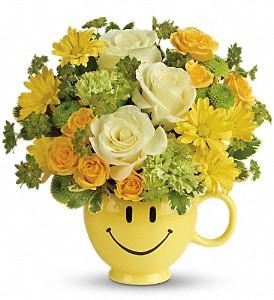 Summer Flower Arrangement of light green and yellow flowers.