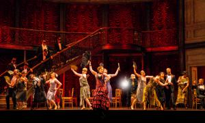 Performers gather in the Parisian dance hall in Verdi's La Traviata at Vancouver Opera