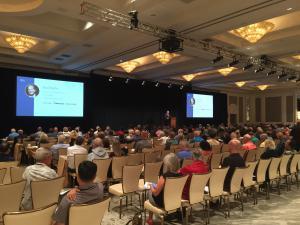 Brad Deflin speaking at Total Wealth Symposium in Las Vegas 2018