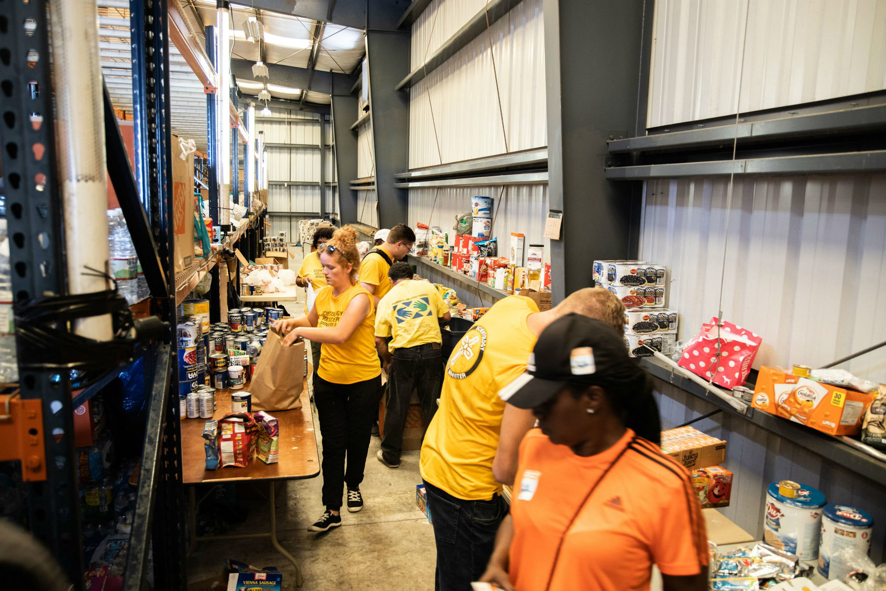Volunteer Ministers helped organize the warehouse to ensure the supplies were ready to distribute.