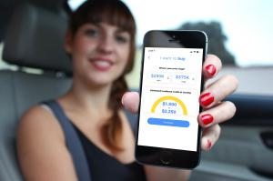 blurred photo of a woman holding her phone showing estimated cashback on screen from Cashifyd app